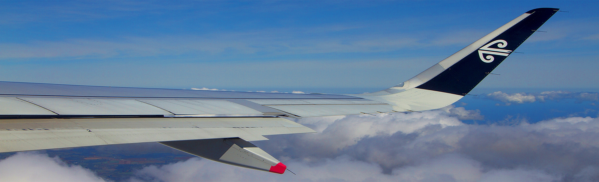 Clouds AirNZ Wing 1970x600a